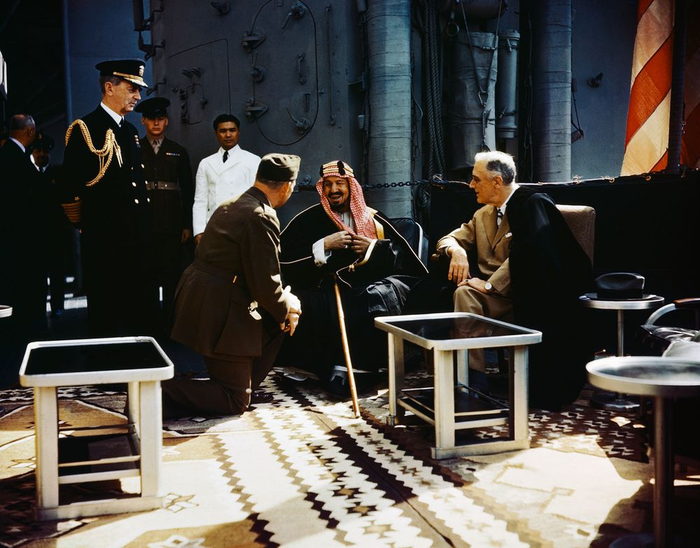 King Abdul Aziz bin Abdul Rahman Al Saud (Ibn Saud) of Saudi Arabia in conference with President Franklin Delano Roosevelt aboard the USS Quincy, February 14, 1945.