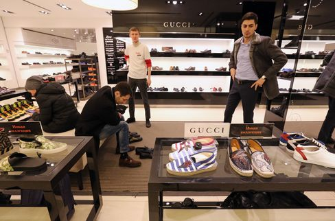 Customers try on shoes in the TsUM department store in Moscow.
