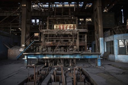 Machinery sits idle in an abandoned steel plant in Tangshan.