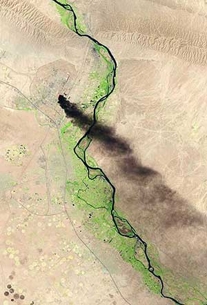 A satellite view shows smoke billowing from the Baiji North refinery complex on June 18 in Baiji, Iraq
