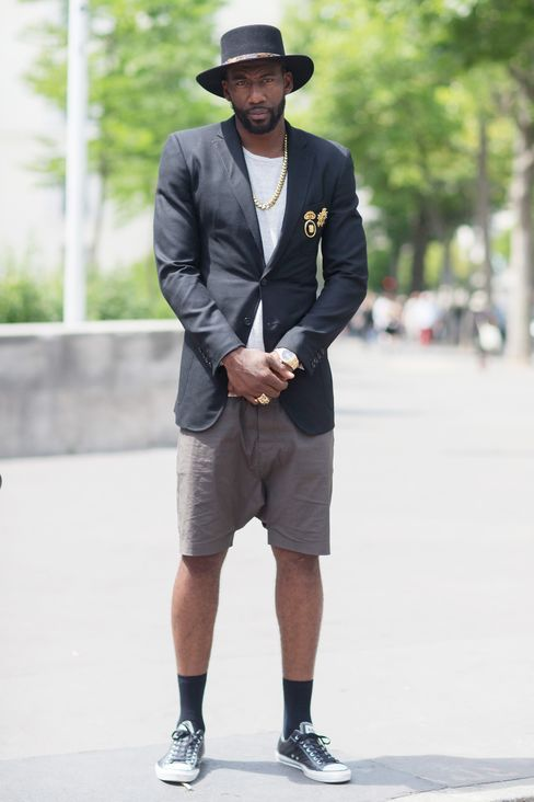 Amar'e Stoudemire outside of the Louis Vuitton show in Paris in a Saint Laurent hat, Ovadia & Sons jacket, Rolex watch, and Rick Owens shorts.
