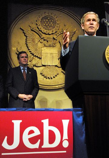 President George W. Bush speaks as his brother, Florida Governor Jeb Bush, looks on during a fundraiser on Jan. 9, 2002, in Washington. President Bush leaped back into domestic politics, raising money for the re-election campaign of his brother.