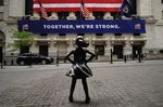 Fearless girl in front of New York Stock Exchange during the