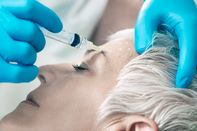 Woman Having Botox Injected In Her Face