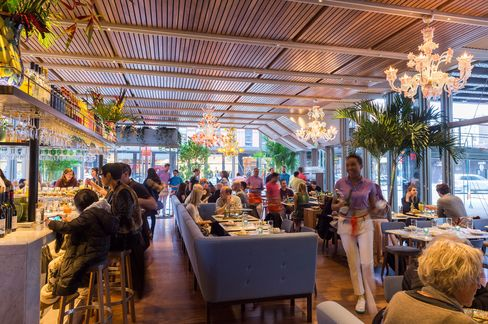 Santina's dining room, under the High Line, is light and bright.
