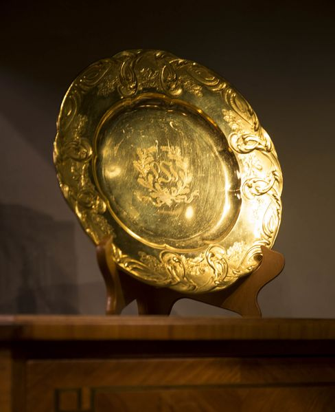"The ""W""-emblazoned gold plate near the ballroom elevators."