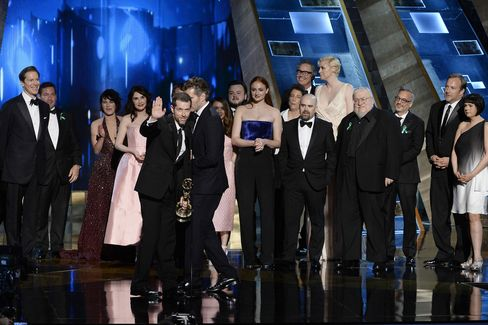 """The cast and crew of """"Game Of Thrones"""" accept the outstanding drama series award"""