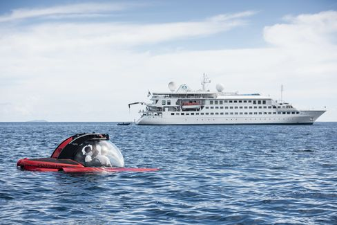 Crystal Esprit's two-passenger, submersible vessel in front of the cruise ship.