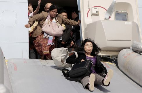 Passengers are evacuated from a Cathay Pacific Boeing 747 aircraft that aborted its takeoff from Shanghai Pudong airport in 2011 after smoke was detected.