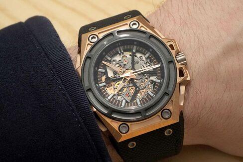 The solid gold SpidoLitehas a black titanium bezel and case back.