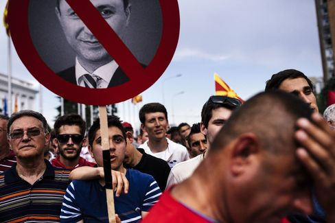 Deomstrators wave Macedonian and Albanian flags during an anti-government protest in downtown Skopje on May 17, 2015.
