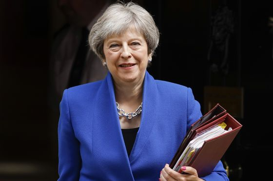 May Fends Off Tory Rebellion to Win Key U.K. Vote on Brexit