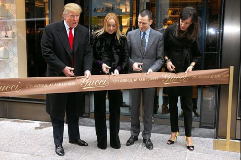 Donald Trump joins Gucci Creative Director Frida Giannini, Gucci CEO Mark Lee, and Gucci President Daniella Vitale for the new flagship store ribbon cutting at Trump Tower on Feb. 8, 2008, in New York City.