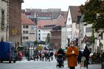 Pedestrians wear protective face masks near retail outlets on Burgstrasse in Nuremburg, Germany, on Monday, Oct. 19, 2020.