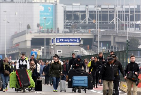 Passengers are evacuated from Brussels airport on March 22.