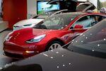 Model 3 between Model S and Model X at the Tesla showroom.