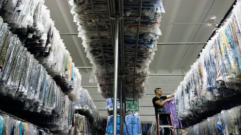 A worker pulls some tops from inventory to fill an order in Miami.