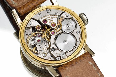 The Longines caliber inside is hand-wound and beautifully finished.