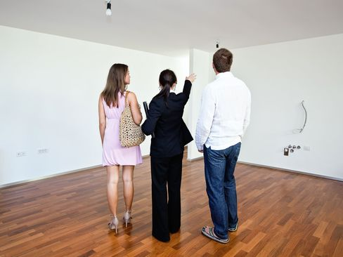 Millennials with a real estate agent, house-hunting.