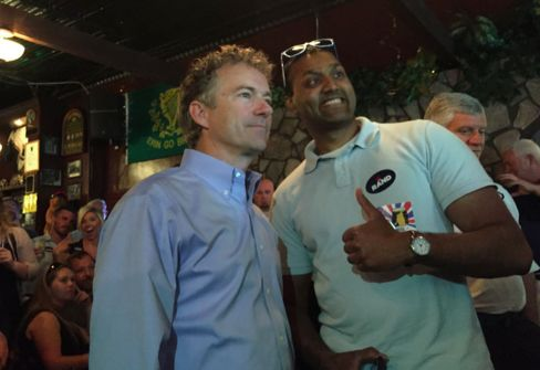 Senator Rand Paul poses with a supporter at a meet-and-greet in Greenville, S.C.