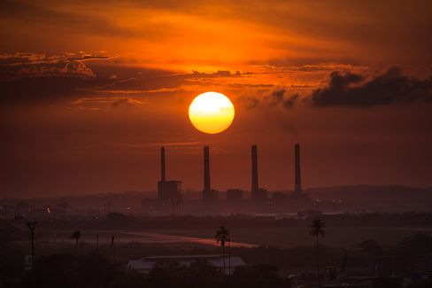 The sun sets over El Palito oil refinery in Puerto Cabello, Venezuela, on Monday, Aug. 24, 2015.