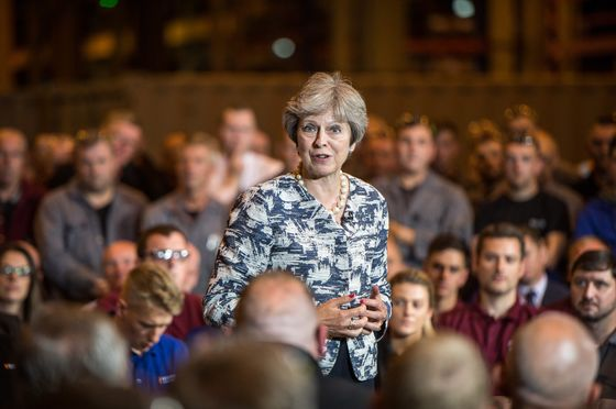 May Tells U.K.'s Leave-Voting Heartlands They Need a Soft Brexit