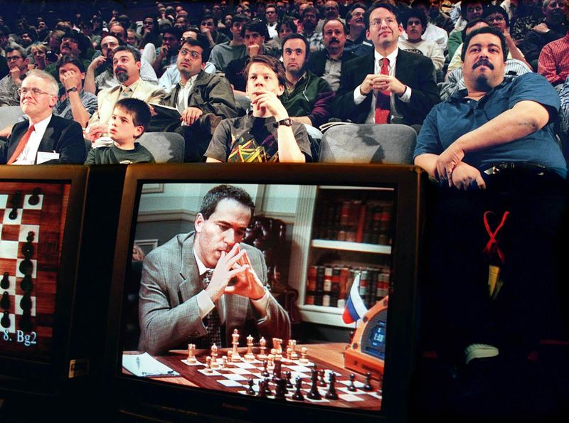 Fans watch the fifth game between World Chess Cham