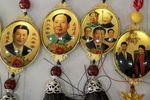 Souvenirs featuring portraits of former Chinese leader Mao Zedong, second left, and Chinese President Xi Jinping.