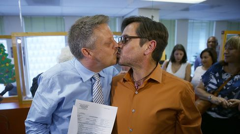 MIAMI, FL - JANUARY 05: Don Johnston (L) and Jorge Diaz kiss after getting a marriage license from the Clerk of the Courts - Miami-Dade County Court on January 5, 2015 in Miami, Florida. Gay marriage is now legal statewide after the courts ruled that the ban on gay marriage is unconstitutional and the Supreme Court declined to intervene.