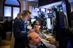 Traders work on the floor of the New York Stock Exchange (NYSE) in New York, U.S., on Tuesday, July 16, 2019.
