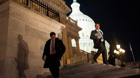 Representative Steven Palazzo, a Republican from Mississippi, left, and Representative Randy Weber, a Republican from Texas, leave the U.S. Capitol following a budget deal vote in Washington, D.C., U.S., on Thursday, Dec. 12, 2013.