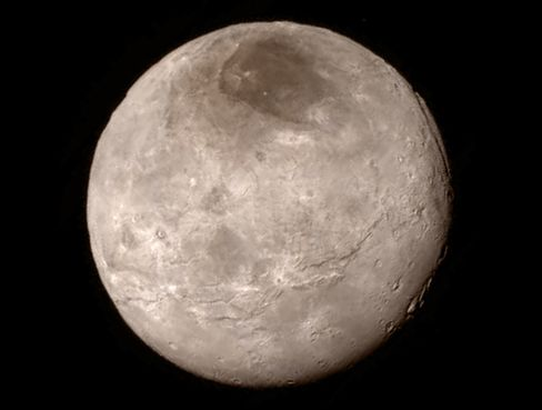 Remarkable new details of Pluto's largest moon Charon are revealed in this image from New Horizons' Long Range Reconnaissance Imager (LORRI), taken late on July 13, 2015, from a distance of 289,000 miles (466,000 kilometers).