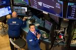 Traders work on the floor of the New York Stock Exchange (NYSE) in New York, U.S., on Tuesday, Feb. 6, 2018. U.S. stocks rebounded from a violent selloff to post the biggest rally in 15 months as investors poured back into some of the most beaten-down sectors.