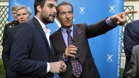 French telecom group Altice President Patrick Drahi, right, with Quantmetry President Jeremy Harroch on June 24, 2015 in Paris.