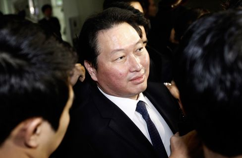 SK Group Chairman Chey Tae-won arrives at the Seoul Central District Court in Seoul, South Korea, on Jan. 31, 2013. Chey is currently serving a prison sentence for embezzling millions of dollars of company money for personal investments.
