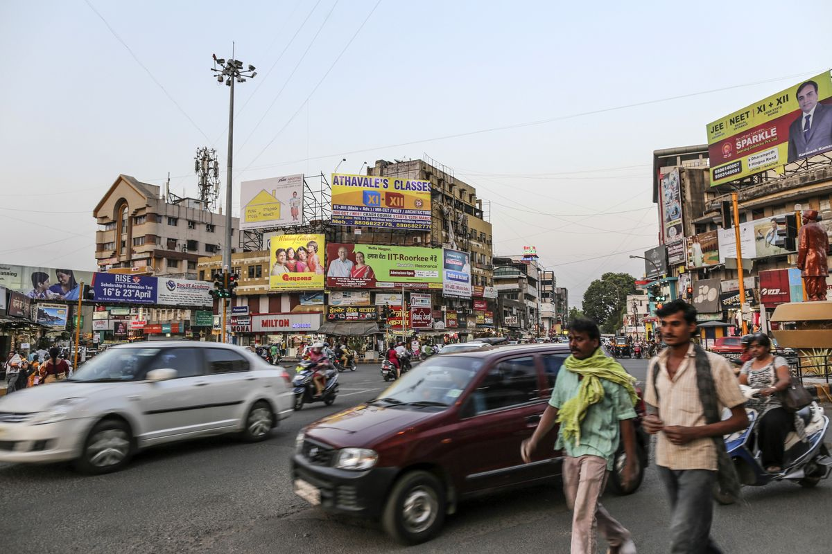 India Cuts Tax on Goods and Services After $20 Billion Stimulus