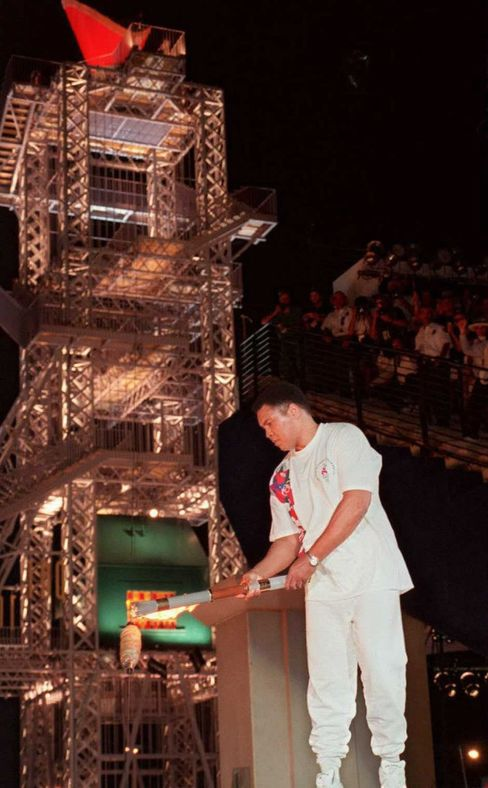 Muhammad Ali lights the flame for the 1996 Olympics.