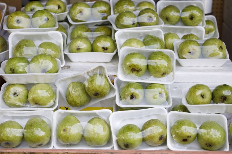 Plastic-wrapped fruit is displayed at a grocery store in Toronto, Ontario.