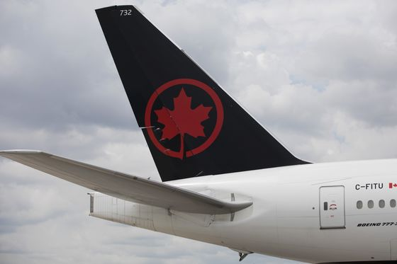 Frosty Trudeau, Empty Airports Await Incoming Air Canada CEO
