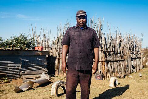 Bongani Nkala outside his home.