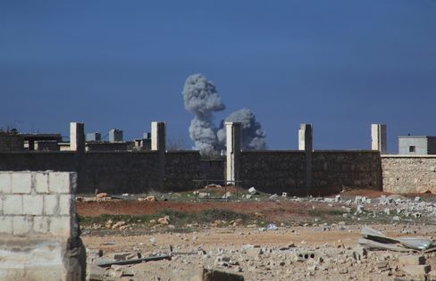 Smoke rises following air strikes on the village of Marasat al-Khan in Syria