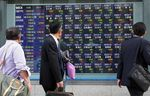 Images Of Tokyo Stock Exchange And Stock Boards As Japan Stocks Jump On BOJ Stimulus