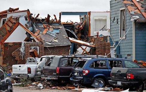 Damaged vehicles and apartments buildings are seen in Garland, Texas on Dec. 28, 2015, after tornadoes hit the area.