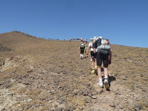 Competitors scale Hered Asfer Jebel, a hill in the Moroccan Sahara, on the second stage of the Marathon des Sables.
