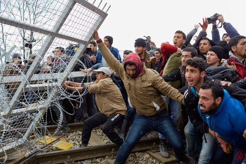Migrants Protest At Border As Greek Bottleneck Worsens