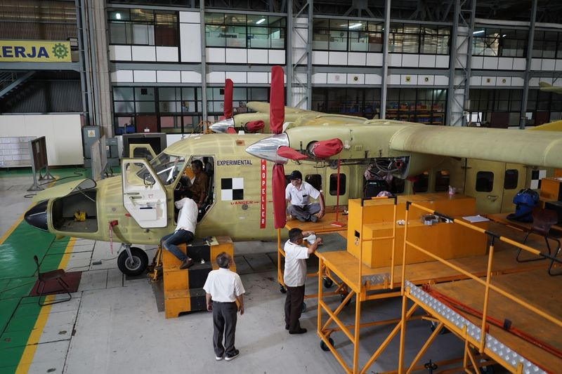 Engineers work on an N 219 prototype aircraft. Image: Dimas Ardian/Bloomberg