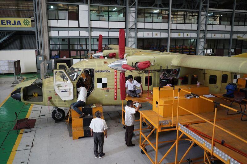 Engineers work on an N 219 prototype aircraft. Image: Dimas Ardian/Bloomberg