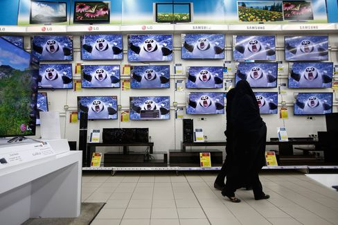 Customers browse flat screen televisions at an electronics store at the Hyperstar supermarket inside the Isfahan City Center shopping mall.