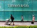 SHANGHAI, CHINA - 2019/08/31: Pedestrians walk past an American luxury jewellery and speciality retailer Tiffany & Co. store in Shanghai. (Photo by Alex Tai/SOPA Images/LightRocket via Getty Images)