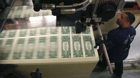 A press printing one dollar bills at the Bureau of Engraving and Printing in Washington, DC.
